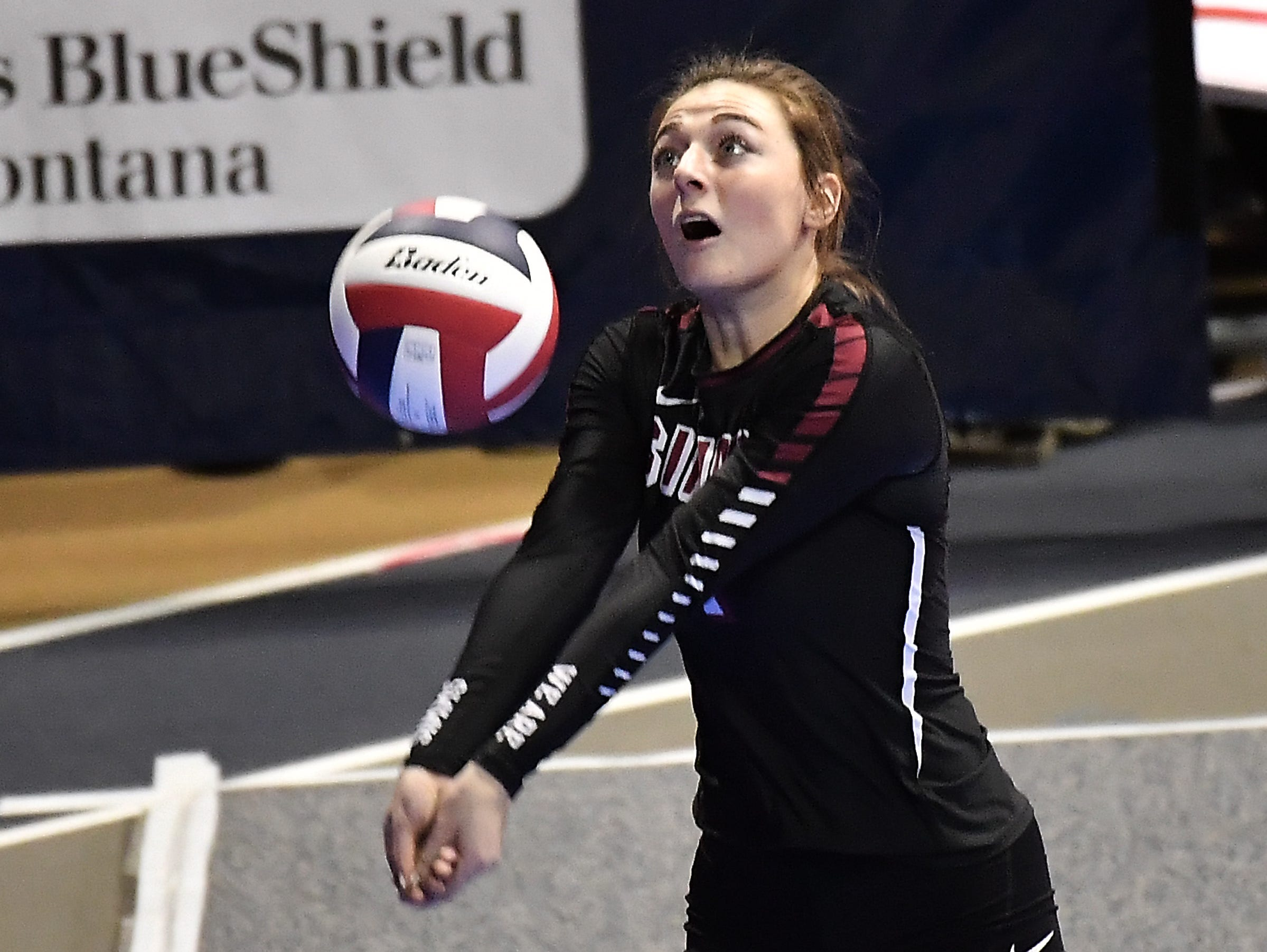 Taylor Jones records a dig for Simms in a match against Bridger at the All-Class State Volleyball Tournament at the Brick Breeden Fieldhouse in Bozeman.