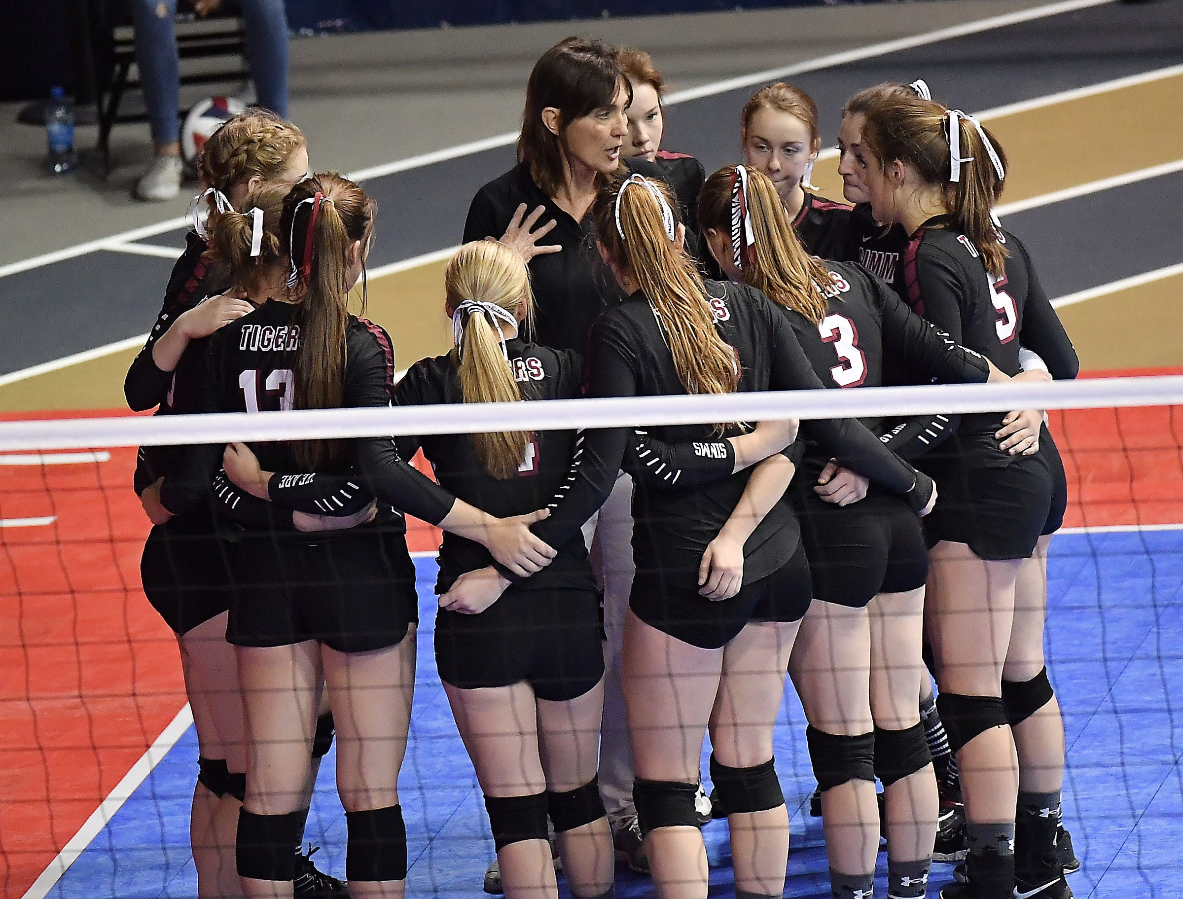Simms head coach Molly Pasma speaks with the Tigers during a match with Bridger at the All-Class State Volleyball Tournament at the Brick Breeden Fieldhouse in Bozeman.