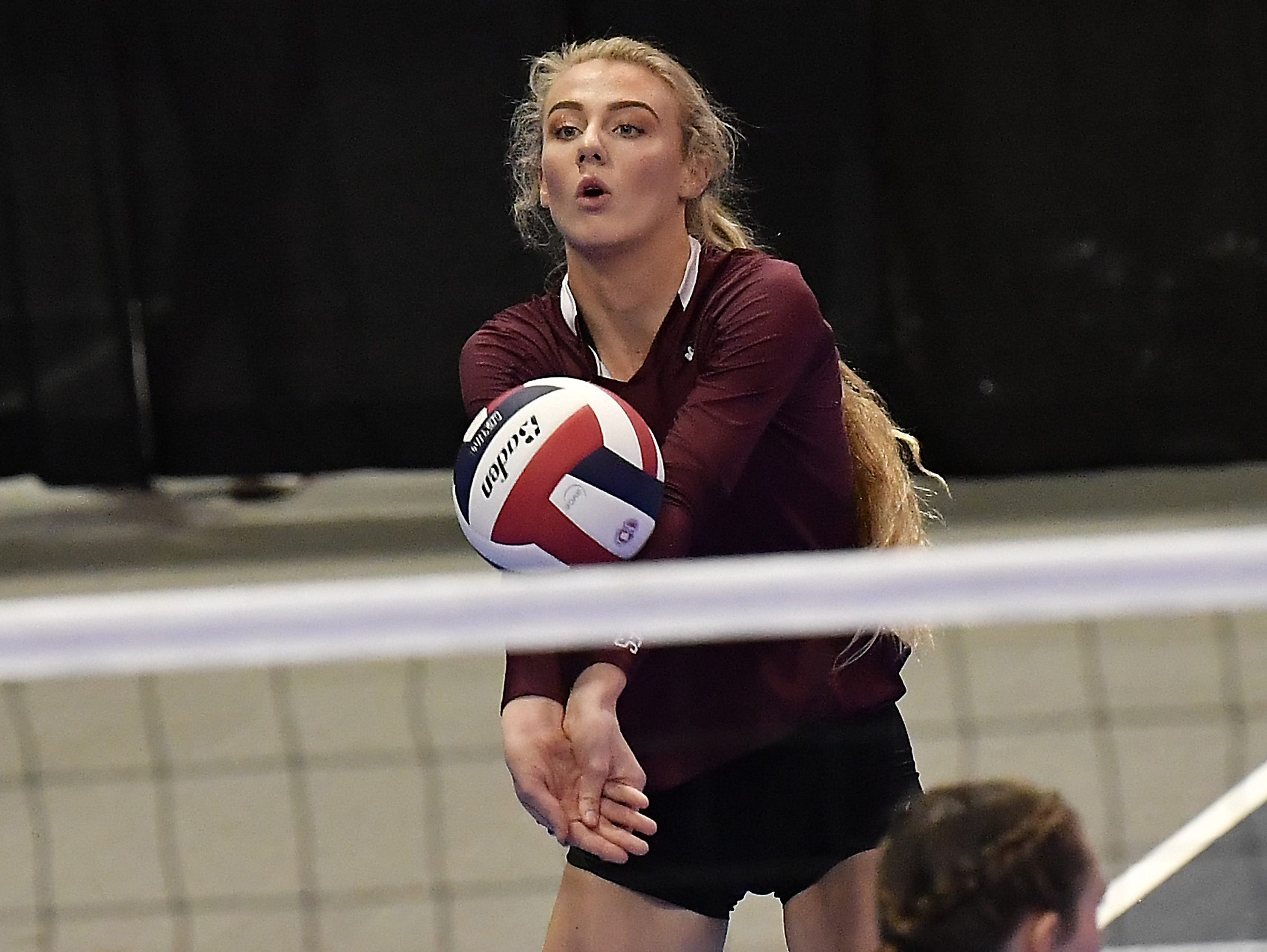 Wolf Point's Abby Juve makes a play on the ball in a match against Huntley Project at the All-Class State Volleyball Tournament at the Brick Breeden Fieldhouse in Bozeman.