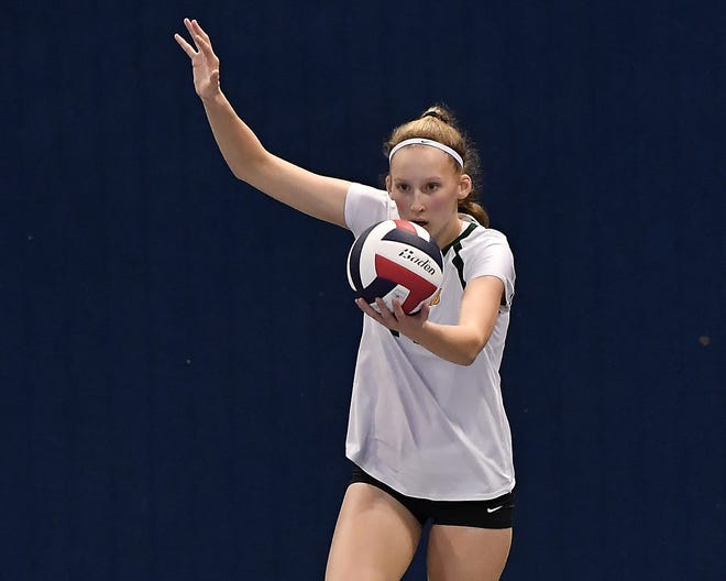 CMR's Allie Olsen serves during a Class AA first-round contest at the All-Class State Volleyball Tournament Thursday.