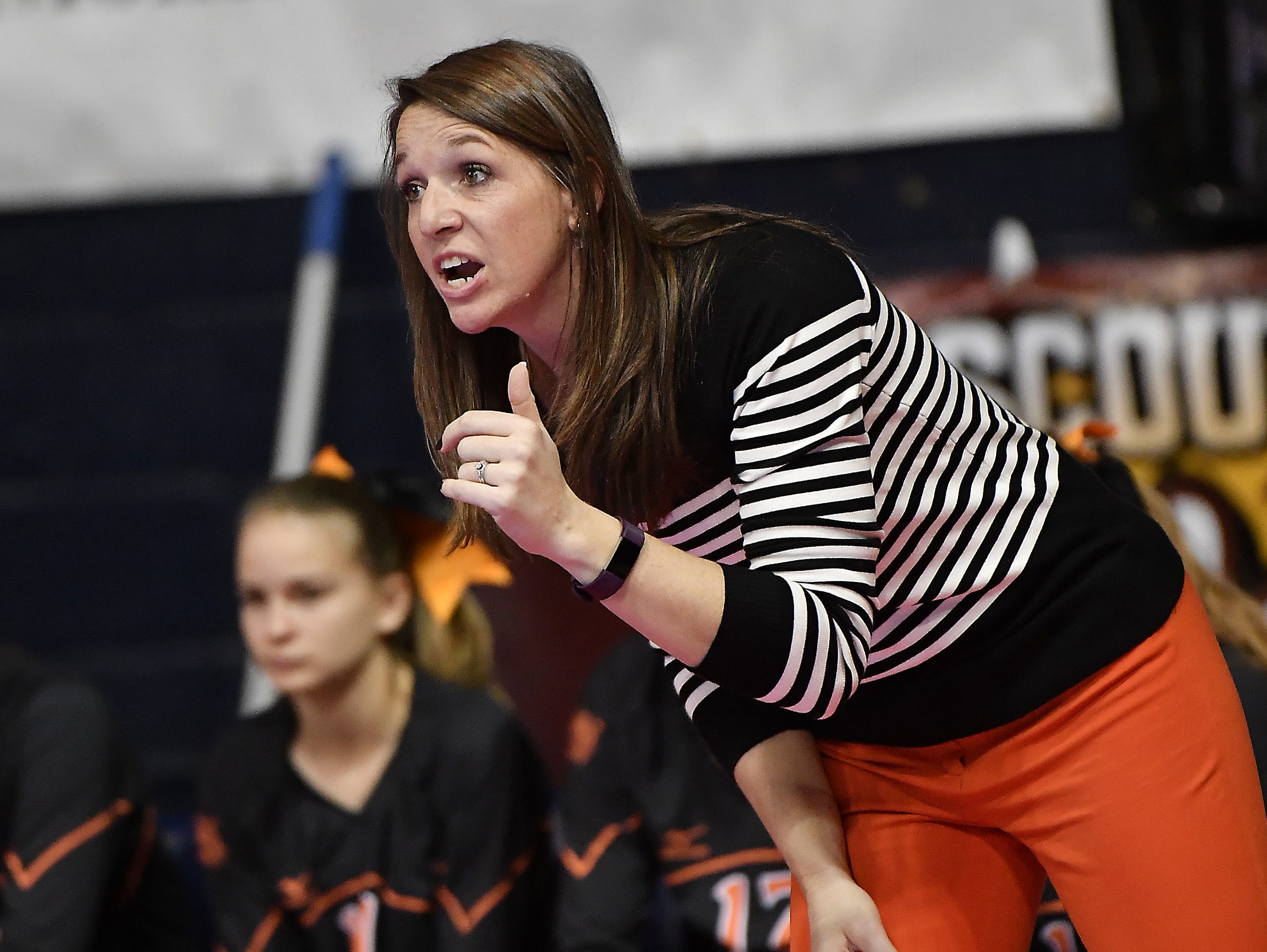 Plentywood head coach Becky Kukowski gives instructions during a match with Manhattan Christian at the All-Class State Volleyball Tournament at the Brick Breeden Fieldhouse in Bozeman.