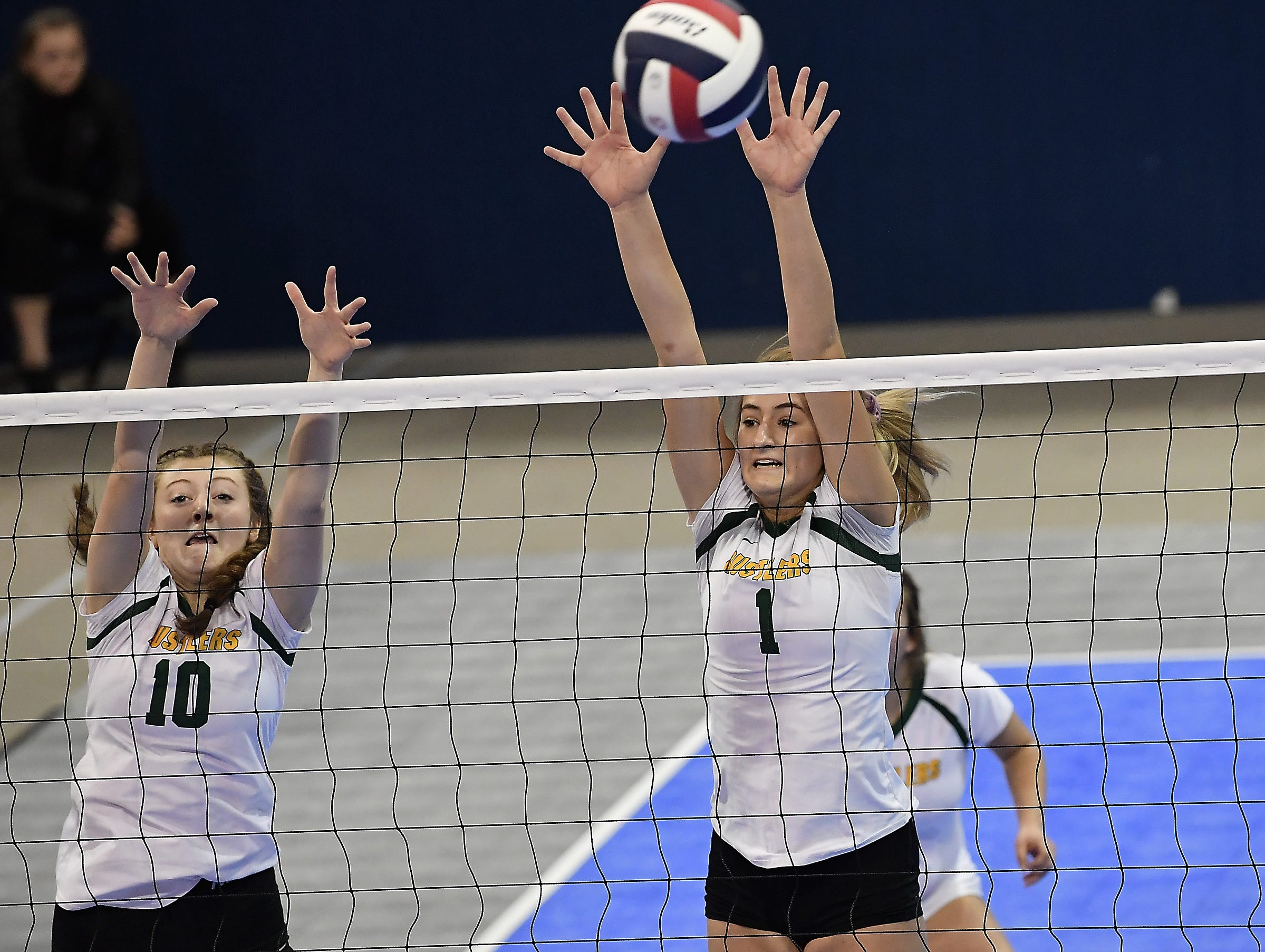 CMR's Maddie Mohlar (1) and Tennisen Hiller (10) defend the net against Helena Capital on Thursday at the All-Class State Volleyball Tournament at the Brick Breeden Fieldhouse in Bozeman.