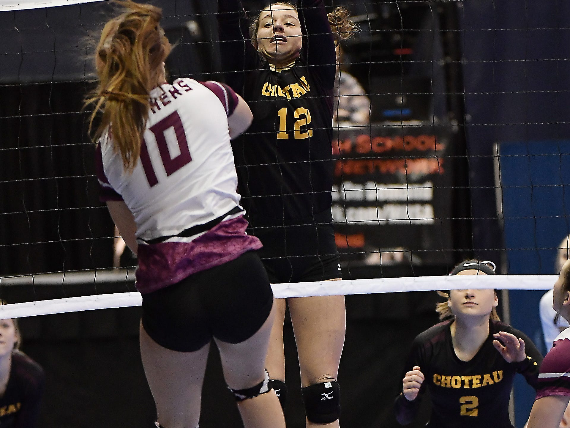 Choteau's Ellie Lee attempts to make a block against Roundup at the All-Class State Volleyball Tournament at the Brick Breeden Fieldhouse in Bozeman.