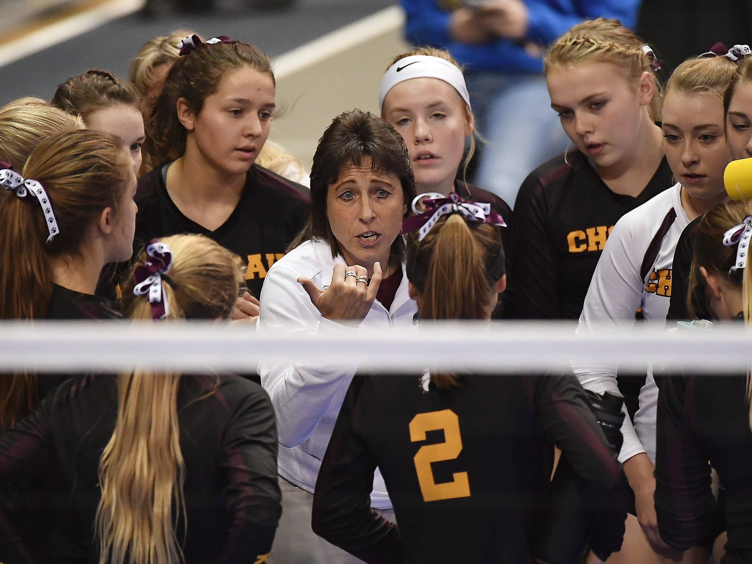 Choteau head coach Ann Funk talks with her team during a match with Roundup at the All-Class State Volleyball Tournament at the Brick Breeden Fieldhouse in Bozeman.