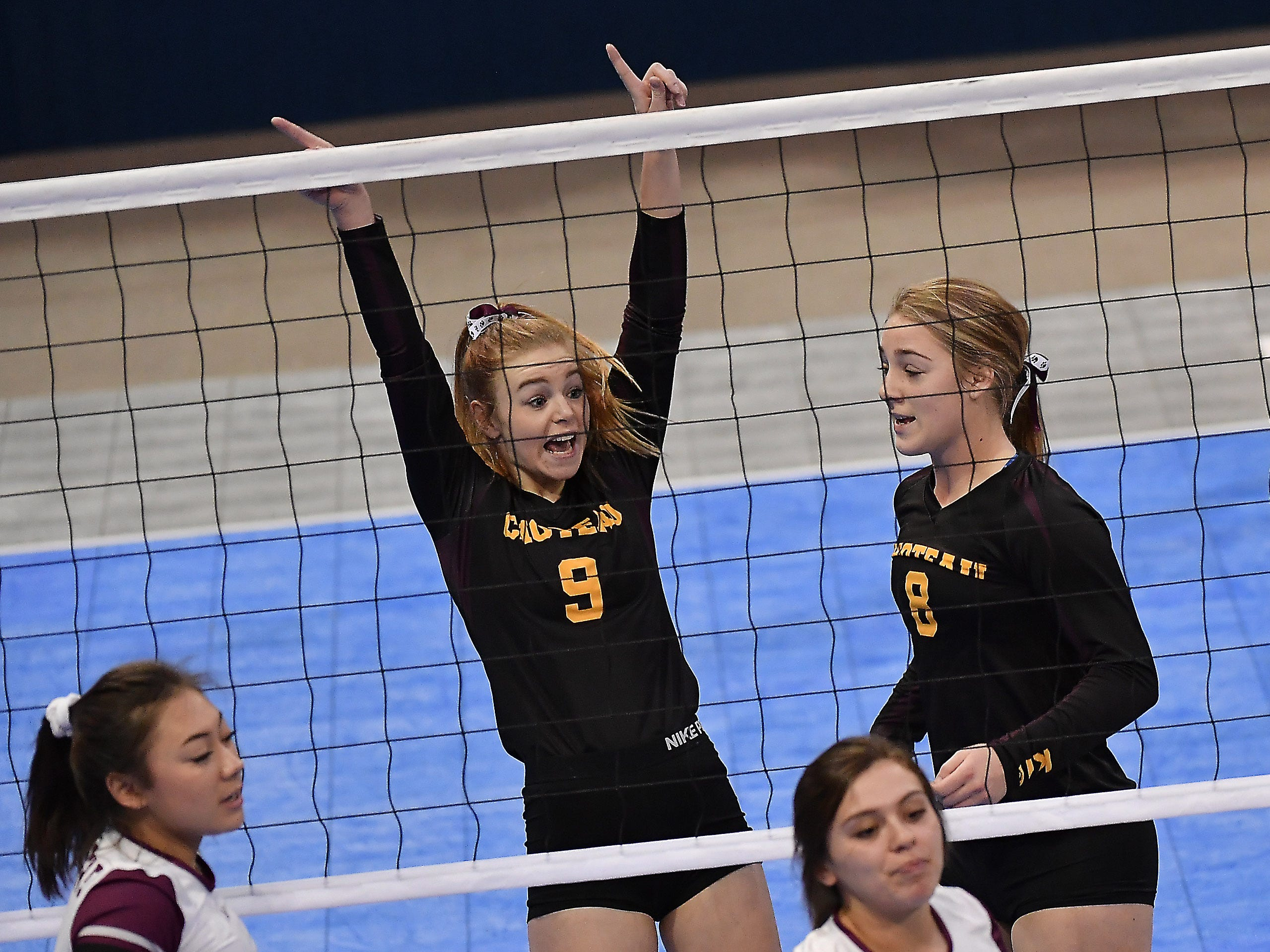 Nicole Krone of Choteau celebrates a point during a match with Roundup at the All-Class State Volleyball Tournament at the Brick Breeden Fieldhouse in Bozeman.