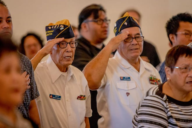 Veterans salute during a funeral ceremony Thursday at the Guam Veterans Cemetery in Piti