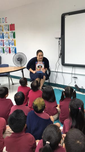 To inspire young girls to follow in the steps of women leaders, Senator Telena Cruz Nelson read to children from Ms. Vernalynn Guerrero's 2nd Grade Class at Tamuning Elementary School a story book – and taught them an important lesson about leadership.