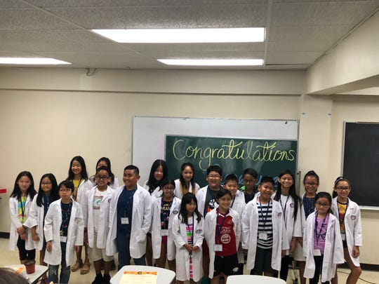 Children in the Guam GENE-ius science program at the University of Guam graduated from the seven-week course on Oct. 27 at the university's College of Natural & Applied Sciences.