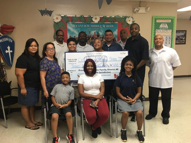 """Prince Hall Masonic Family, District 8 presented Terrance M. Baker III, """"Stop Bullying"""" award to Oceanview Middle School PTO. Three schools received a total of $900 in award money and 10 school uniforms for support of various school programs and its youth.  Prince Hall Mason President- Derrick D. Randle, Scottish Rite Mason President- Cornelius D. Lyles; Heroines of Jericho President- Theresa Babauta, District Deputy- Clifton Claybrooks and Prince Hall Masonic Family, District 8 President-Gregory Nicholson."""