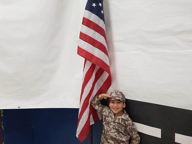 In this photo of the week submission, five-year-old James Taga II salutes the United States flag while in a military costume in this November 2018 photo.