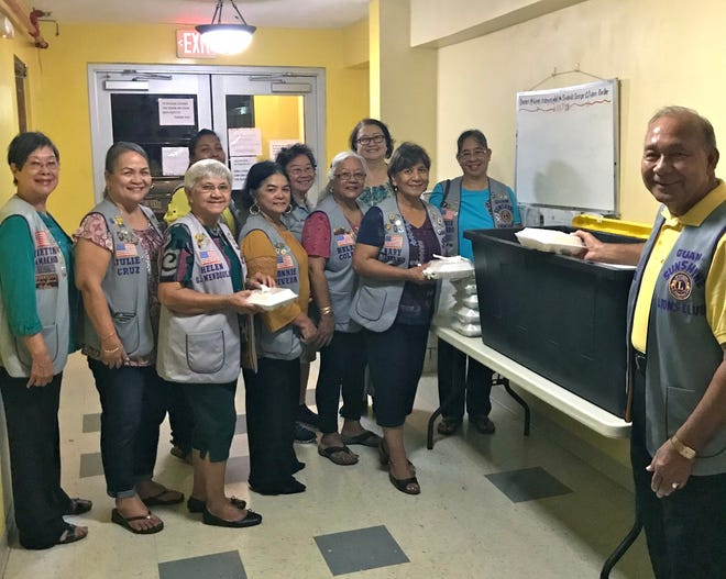 The Guam Sunshine Lions Club provided meals to residents of Guma San Jose in Dededo on October 23. Pictured from left: Lions Marietta Camacho, Julie Cruz, Helen Mendiola, Connie Cruz, Helen Colby, Mary Taitano, and Annie Artero. Back from left: Lions Tish Tano, Clare Cruz, Doris Limtiaco and President Pete Babauta.