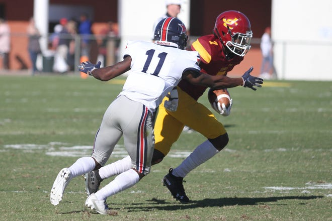 """Bobcat receiver Natorian """"Deuce"""" Watts (7) tries to get past Northwest's Brandin Echols (11) last week. Watts had five receptions for 107 yards and two touchdowns as Jones won the game, 36-34."""