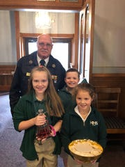 Veteran Jim Hanley and his grandchildren, Milynn Garrett, Hanley Floyd, and Peyton Hanley enter Holy Name Church in preparation for Communion.