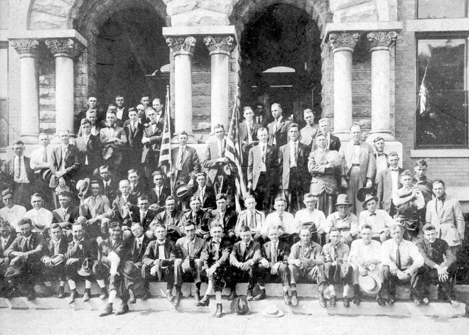 The last contingency of Henderson men to leave for the Army in World War I pose on the steps of the old city building on May 28, 1918, before boarding a train bound for Camp Taylor near Louisville. Some of the men served in France during World War I. One of the soldiers, Martin C. Summers, recalled later that the armistice that ended the war was signed the day before he was to be moved to the front.