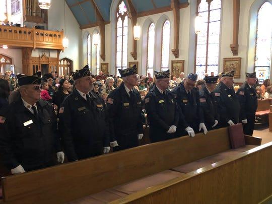 American Legion Worsham Post 40 members take part in Thursday's Veterans Day Mass at Holy Name of Jesus Catholic Church