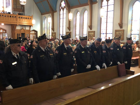 American Legion Worsham Post 40 members take part in Thursday's Veterans Day Mass at Holy Name of Jesus Catholic Church