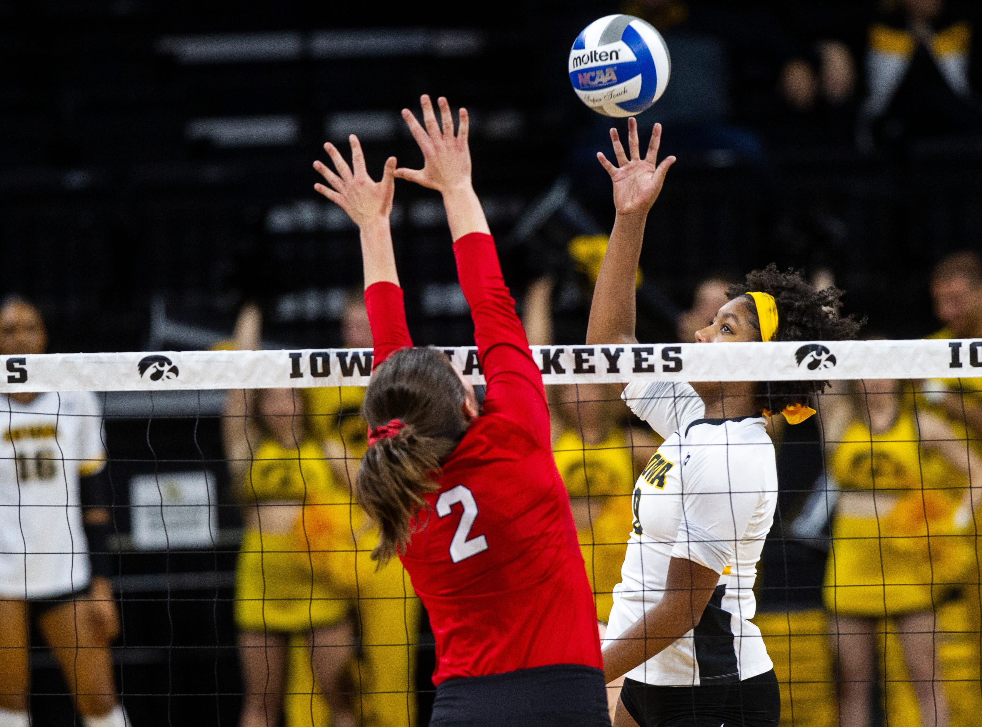 Iowa middle blocker Amiya Jones (9) gets a ball past Nebraska's Mikaela Foecke (2) during an NCAA volleyball game on Wednesday, Nov. 7, 2018, at Carver-Hawkeye Arena in Iowa City.