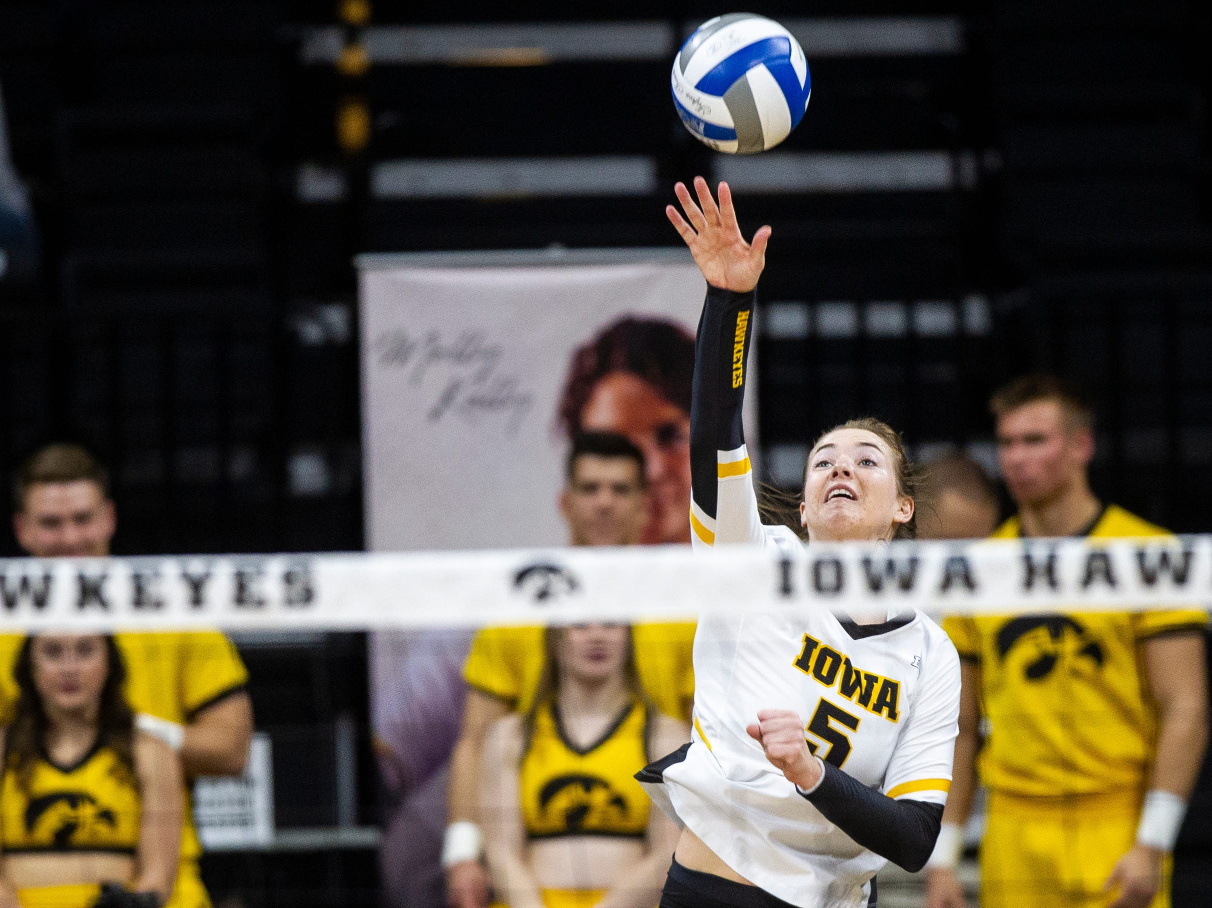 Iowa outside hitter Meghan Buzzerio (5) serves during an NCAA volleyball game on Wednesday, Nov. 7, 2018, at Carver-Hawkeye Arena in Iowa City.