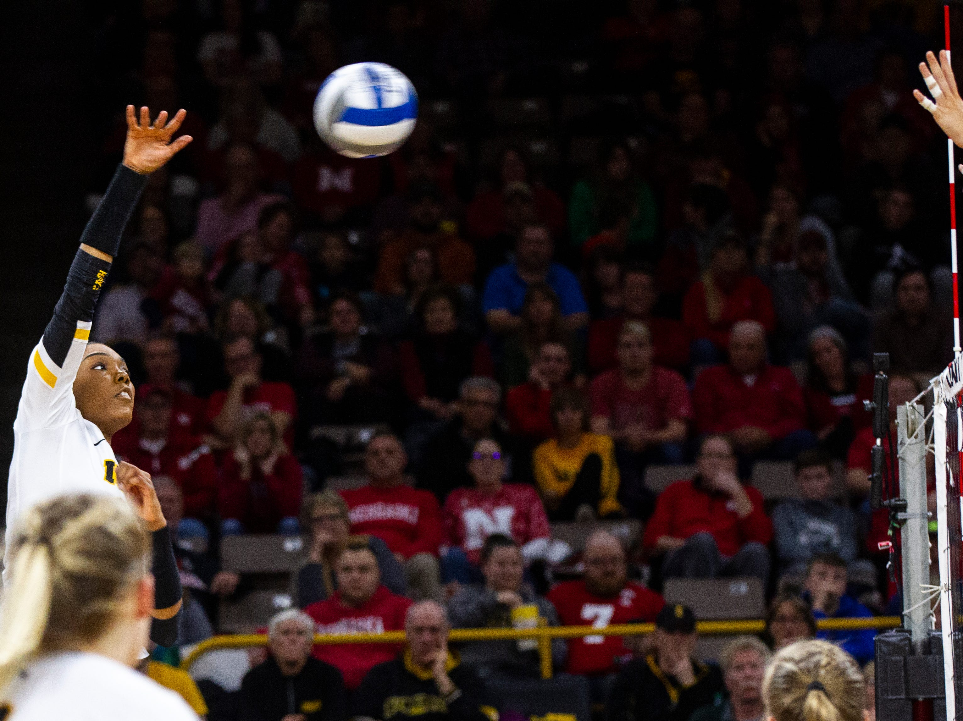 Iowa defensive specialist Maddie Slagle (15) attempts a kill during an NCAA volleyball game on Wednesday, Nov. 7, 2018, at Carver-Hawkeye Arena in Iowa City.