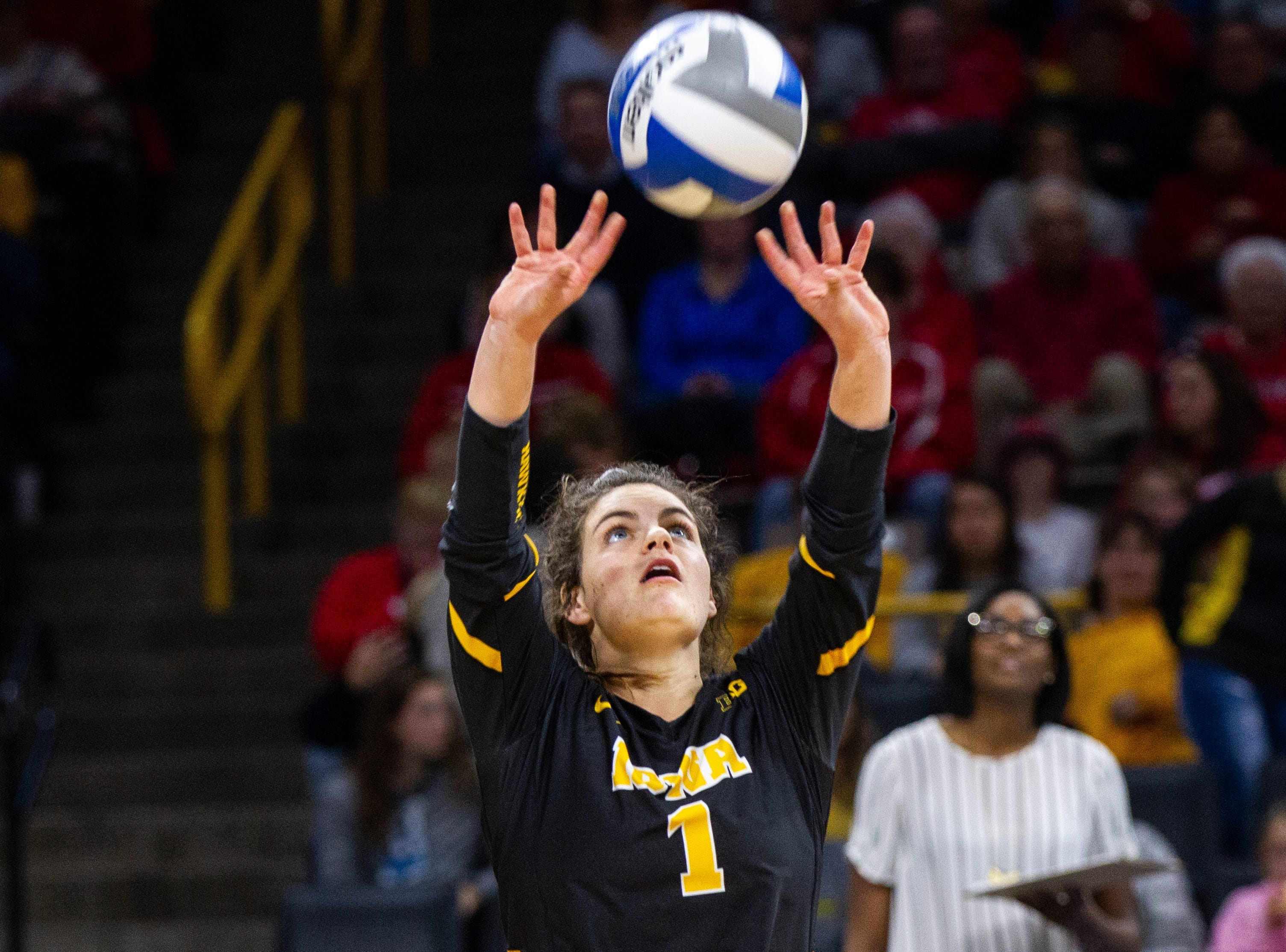 Iowa defensive specialist Molly Kelly (1) sets the ball during an NCAA volleyball game on Wednesday, Nov. 7, 2018, at Carver-Hawkeye Arena in Iowa City.