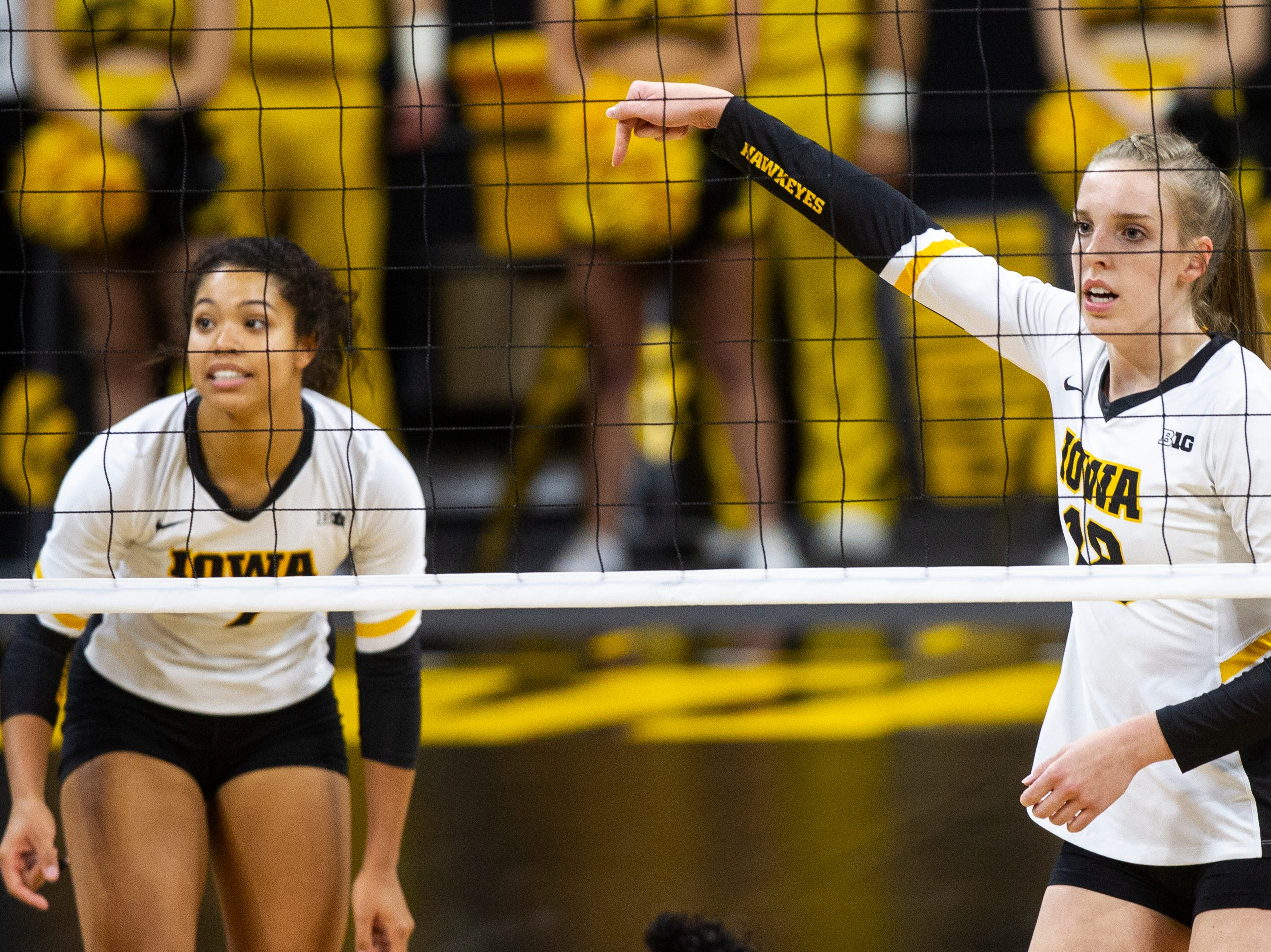 Iowa middle blocker Hannah Clayton (18) gestures to teammates during an NCAA volleyball game on Wednesday, Nov. 7, 2018, at Carver-Hawkeye Arena in Iowa City.