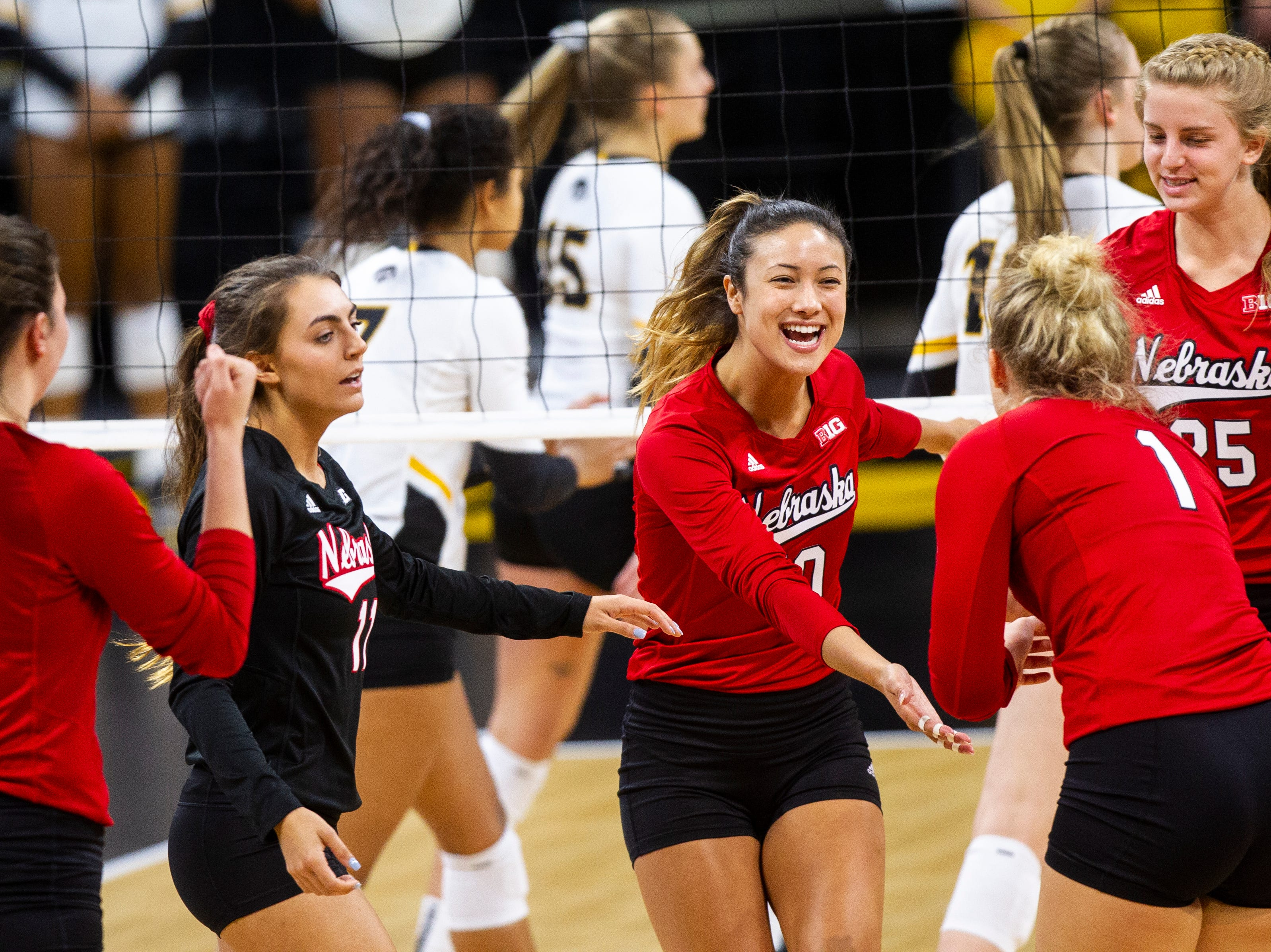 Nebraska's Lexi Sun (10) celebrates a point with teammates during an NCAA volleyball game on Wednesday, Nov. 7, 2018, at Carver-Hawkeye Arena in Iowa City.