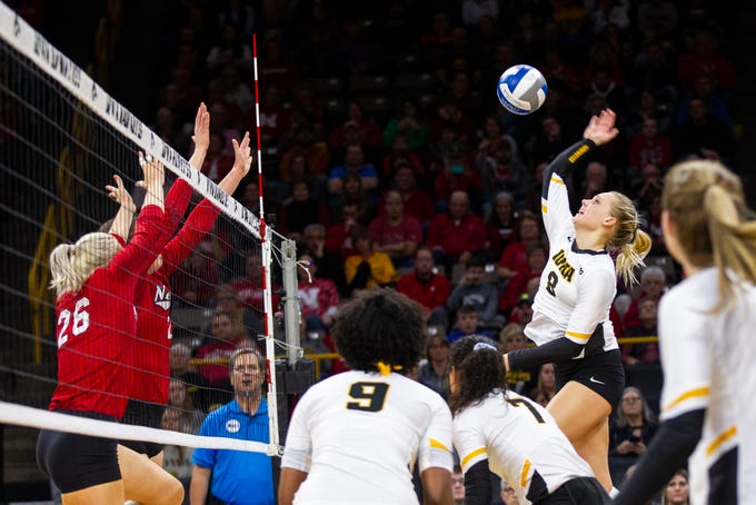 Iowa's Reghan Coyle (8) goes up for a kill during an NCAA volleyball game on Wednesday, Nov. 7, 2018, at Carver-Hawkeye Arena in Iowa City.