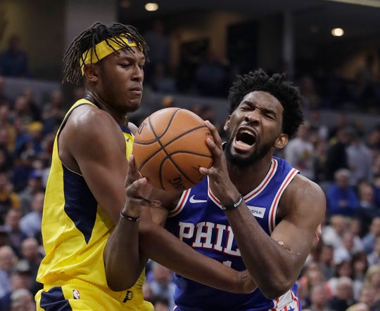 Philadelphia 76ers' Joel Embiid is fouled by Indiana Pacers' Myles Turner during the first half of an NBA basketball game, Wednesday, Nov. 7, 2018, in Indianapolis.