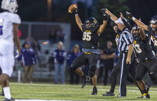 Avon senior Jayden Williams (95) has nine sacks this season.