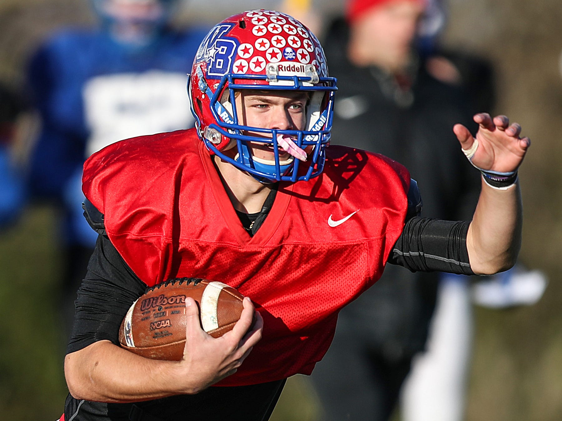 Stars quarterback Spencer Wright (7) keeps the ball while running a play during practice at Western Boone Junior-Senior High School in Thornton, Ind., Wednesday, Nov. 7, 2018. Western Boone faces Scecina on Friday, Nov. 9, in the regional championship.