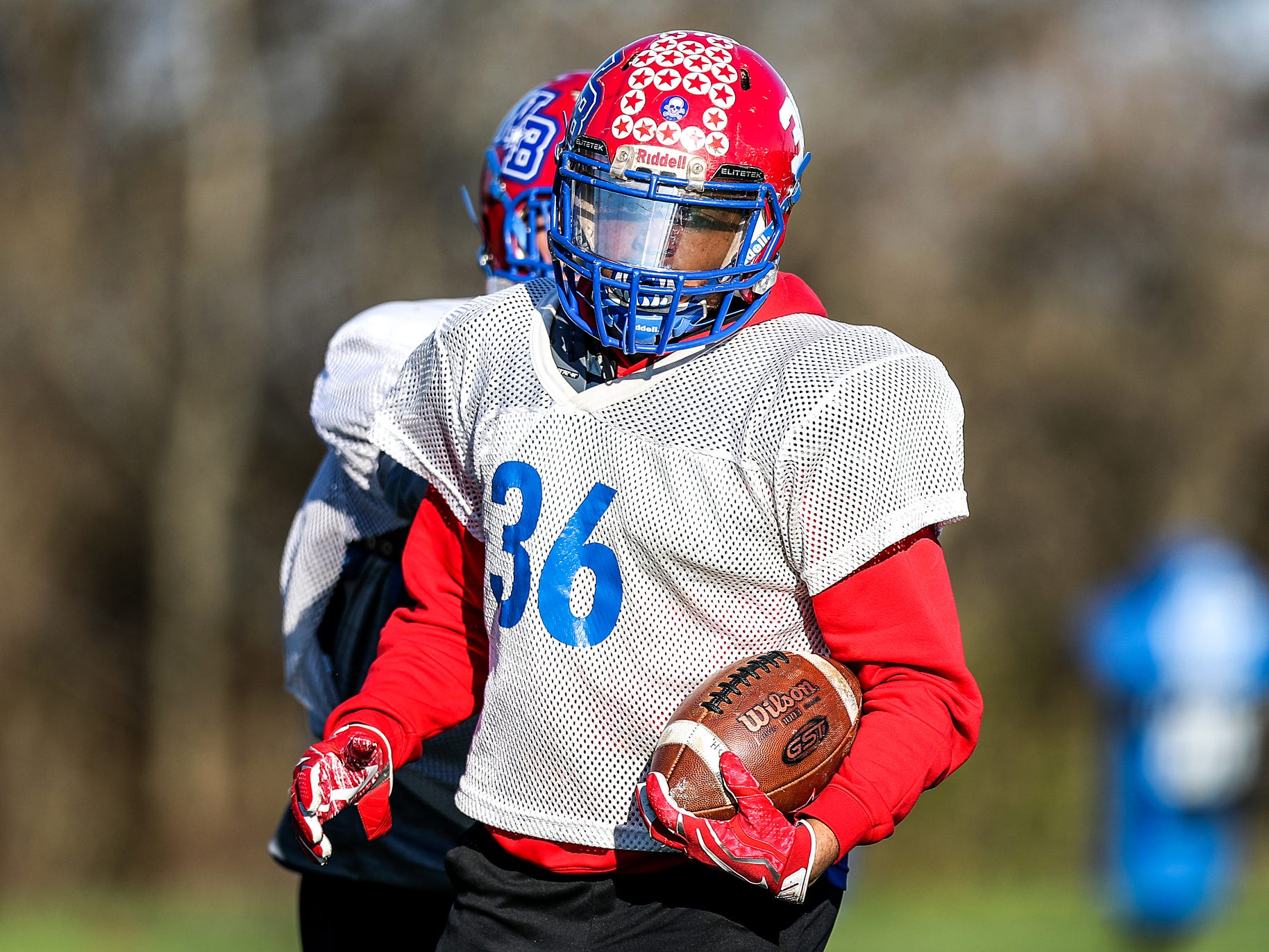 Stars running back Kruze Washington (36) holds the ball after finishing a practice drill at Western Boone Junior-Senior High School in Thornton, Ind., Wednesday, Nov. 7, 2018. Western Boone faces Scecina on Friday, Nov. 9, in the regional championship.
