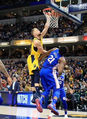 Domantas Sabonis #11 of the Indiana Pacers dunks the ball while defended by Joel Emblid #21of the Philadelphia 76ers at Bankers Life Fieldhouse on November 7, 2018 in Indianapolis, Indiana.