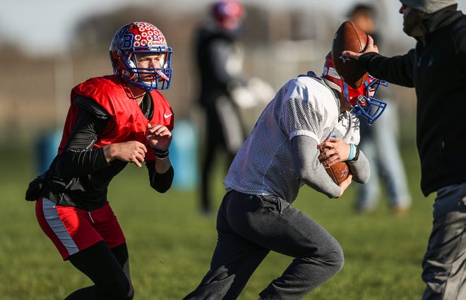 Stars quarterback Spencer Wright (7), left, takes direction from head coach Justin Pelley, far right, during practice at Western Boone Junior-Senior High School in Thornton, Ind., Wednesday, Nov. 7, 2018. Western Boone faces Scecina on Friday, Nov. 9, in the regional championship.