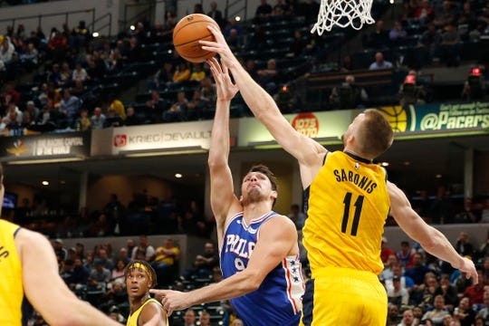Philadelphia 76ers forward Dario Saric (9) has his shot blocked by Indiana Pacers forward Domantas Sabonis (11) during the fourth quarter at Bankers Life Fieldhouse.