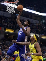 Philadelphia 76ers' Joel Embiid (21) dunks against Indiana Pacers' Myles Turner during the first half of an NBA basketball game, Wednesday, Nov. 7, 2018, in Indianapolis.