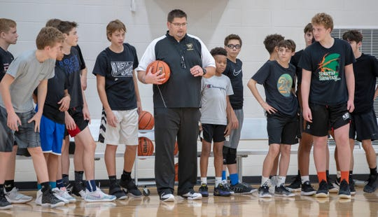 Andy Williams works with players during basketball practice at Mt. Vernon Middle School, Fortville, Monday, Nov. 5, 2018.