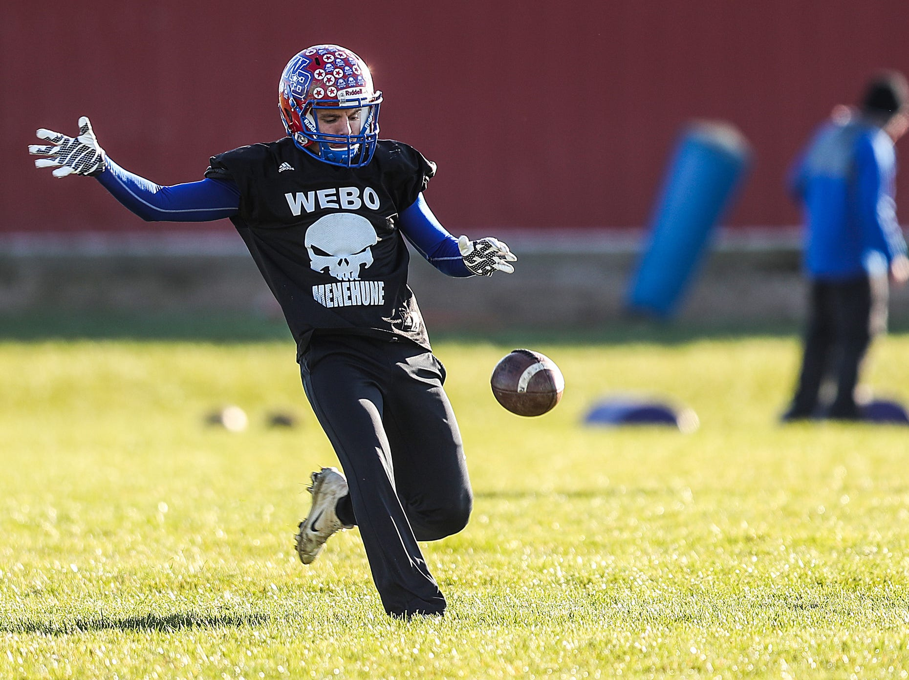 Peyton Young (18) practices punting at Western Boone Junior-Senior High School in Thornton, Ind., Wednesday, Nov. 7, 2018. Western Boone faces Scecina on Friday, Nov. 9, in the regional championship.