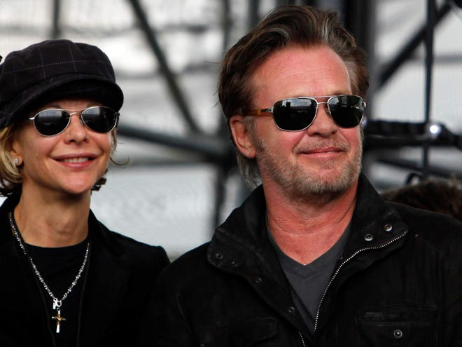 Meg Ryan, left, and John Mellencamp are pictured at the 2012 edition of Farm Aid in Hershey, Pa.