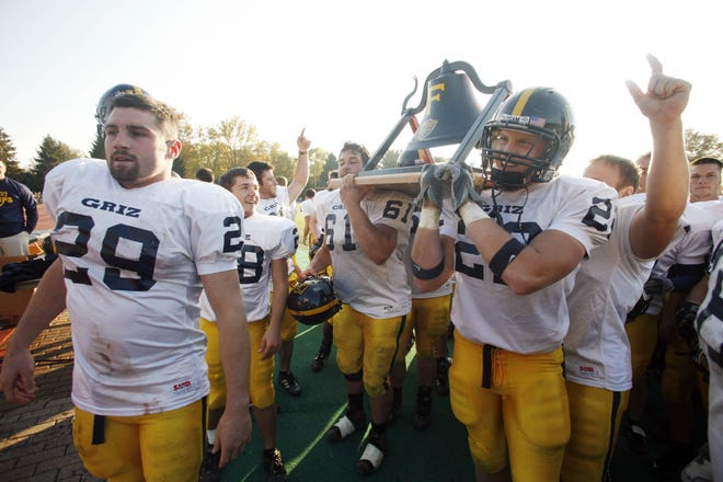 Franklin College players hoisted the Victory Bell in 2007 after defeating Hanover College.