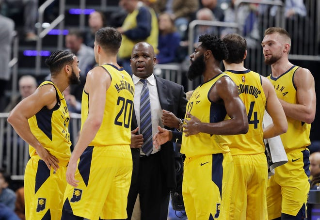 Indiana Pacers head coach Nate McMillan talks to his team during the first half of an NBA basketball game against the Philadelphia 76ers, Wednesday, Nov. 7, 2018, in Indianapolis.