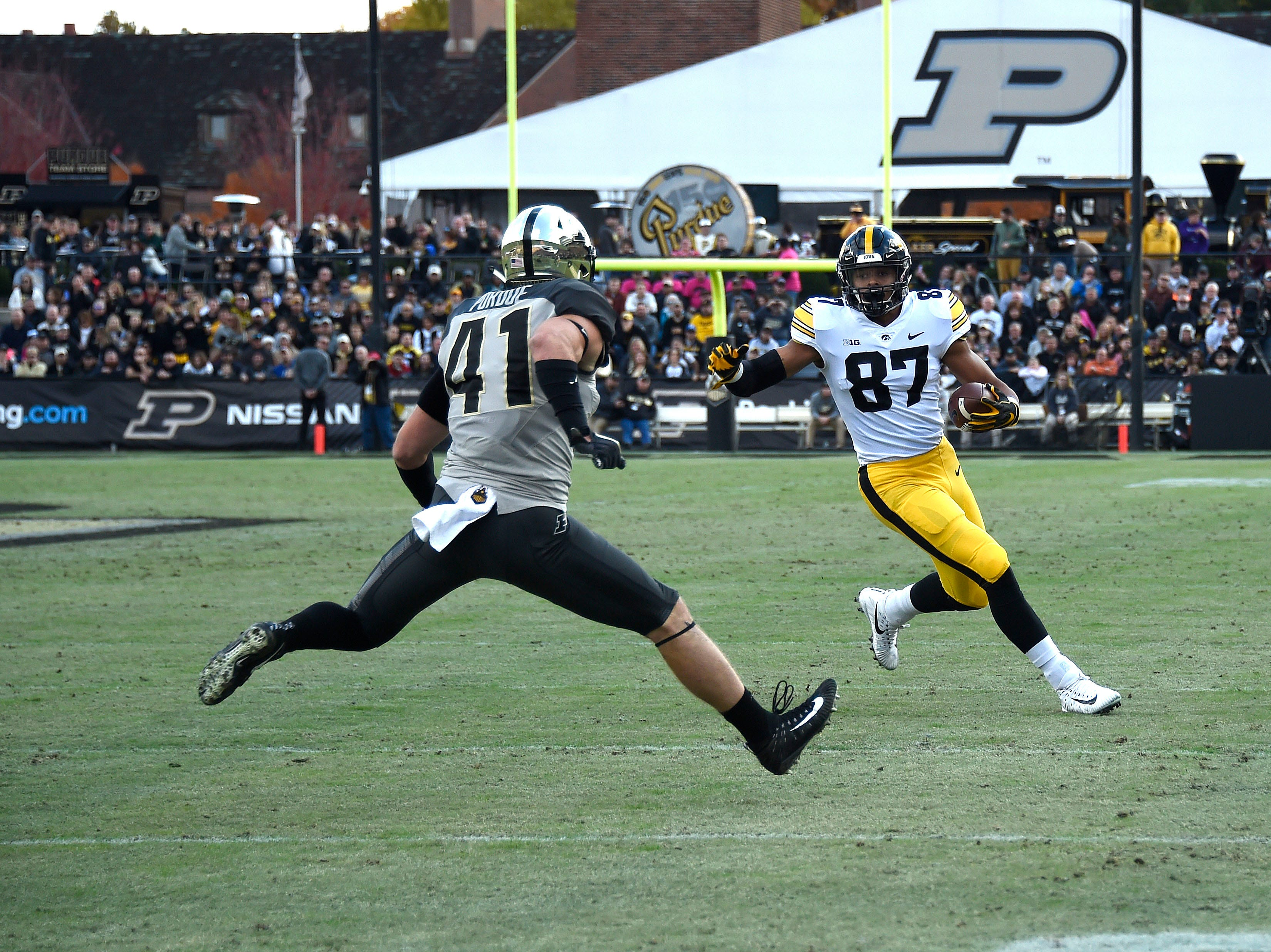 Nov 3, 2018; West Lafayette, IN, USA;  Iowa Hawkeyes tight end Noah Fant (87) runs with the ball as Purdue Boilermakers safety Jacob Thieneman (41) defends in at Ross-Ade Stadium.