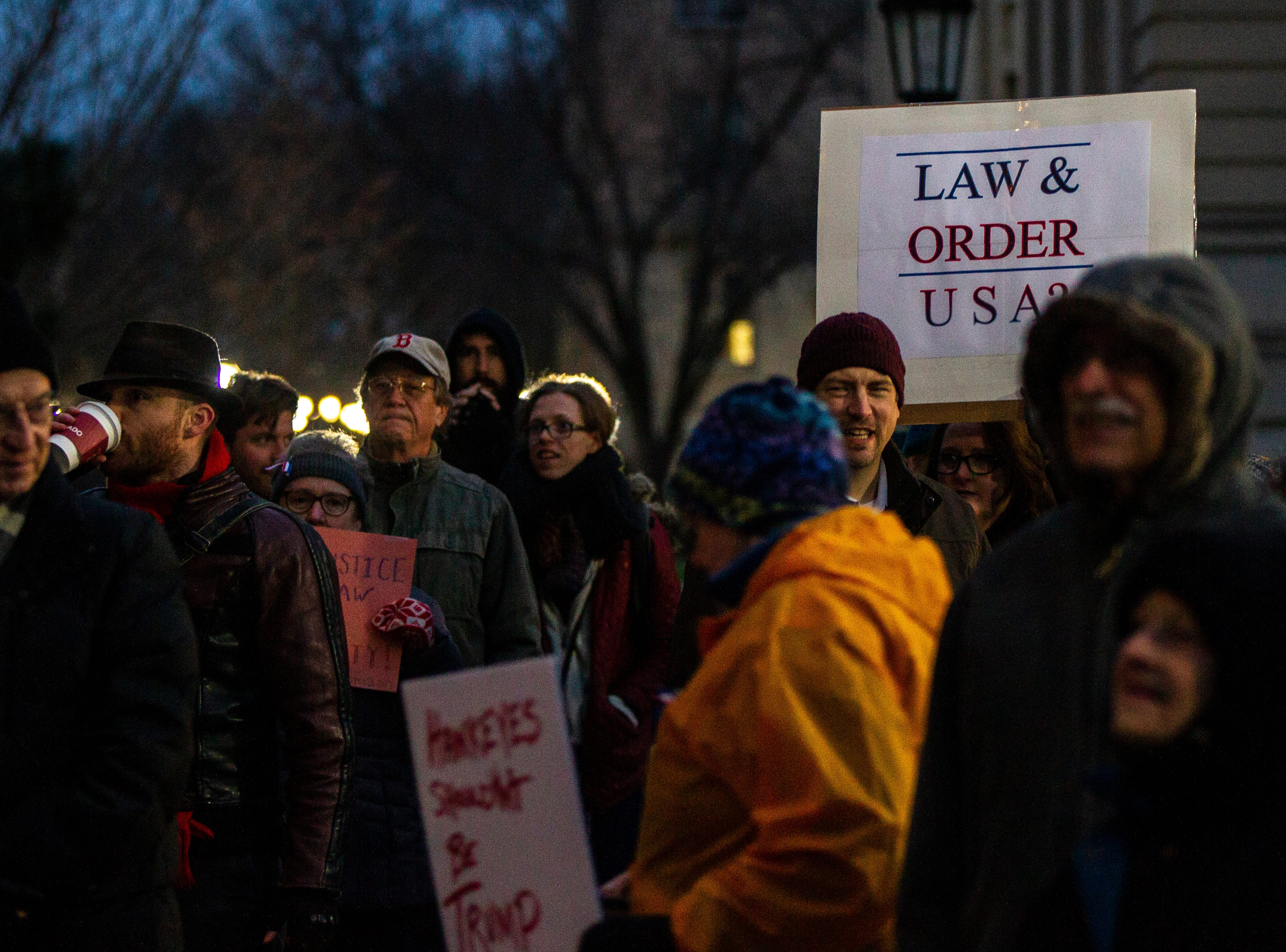 "A sign reading ""Law and Order USA?"" is seen during a protest over the appointment of Matt Whitaker as acting U.S. Attorney General on Thursday, Nov. 8, 2018, on east side of the Pentacrest in Iowa City."