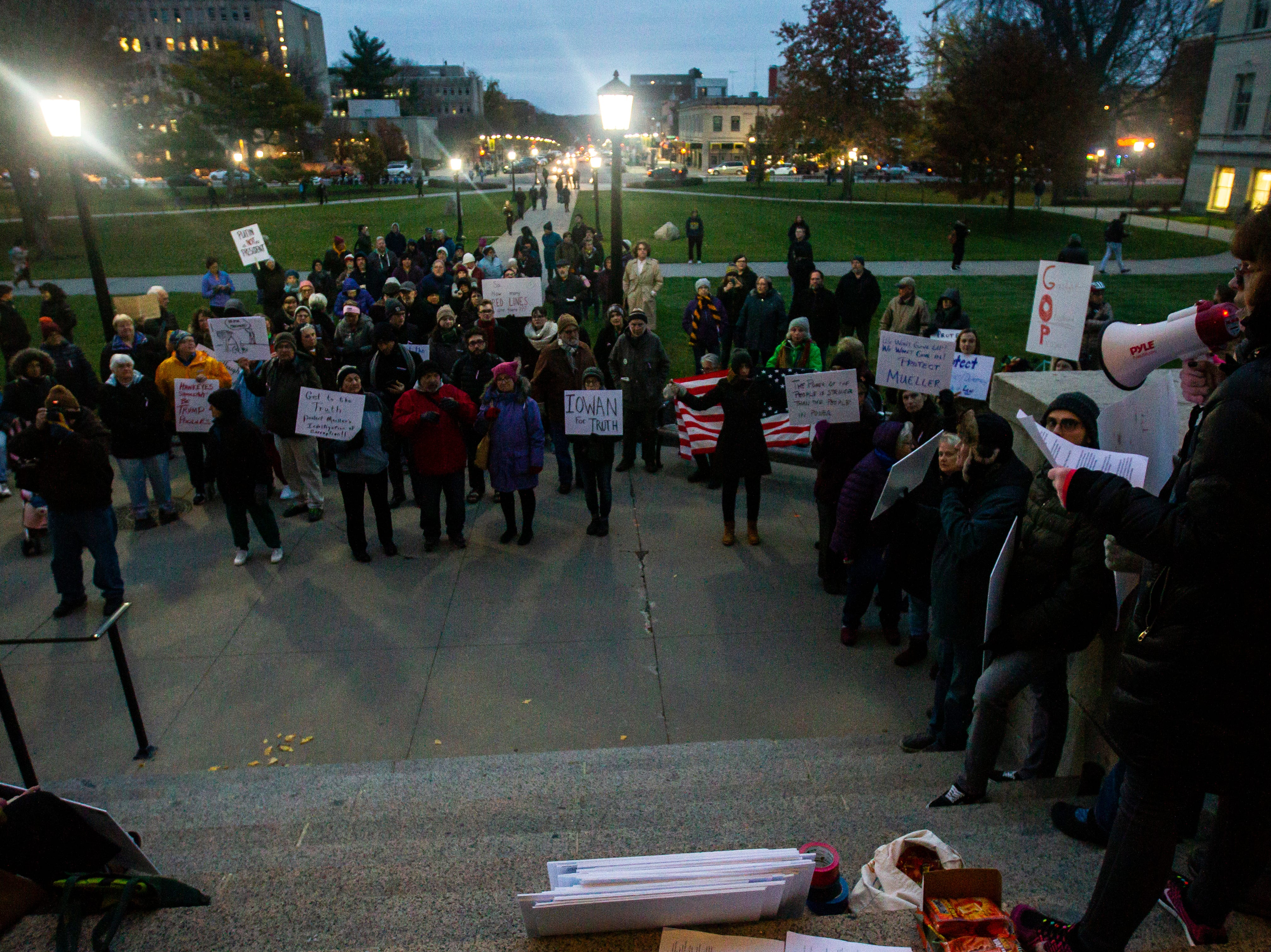 Sara Miller speaks to community members during a protest over the appointment of Matt Whitaker as acting U.S. Attorney General on Thursday, Nov. 8, 2018, on east side of the Pentacrest in Iowa City.