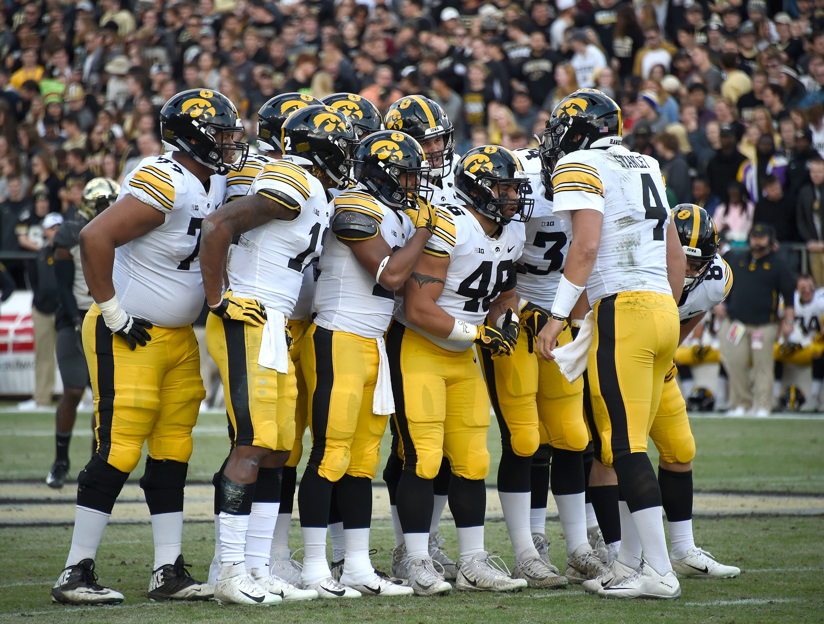 Nov 3, 2018; West Lafayette, IN, USA; Iowa Hawkeyes quarterback Nate Stanley (4) sets up a play in the huddle at Ross-Ade Stadium.
