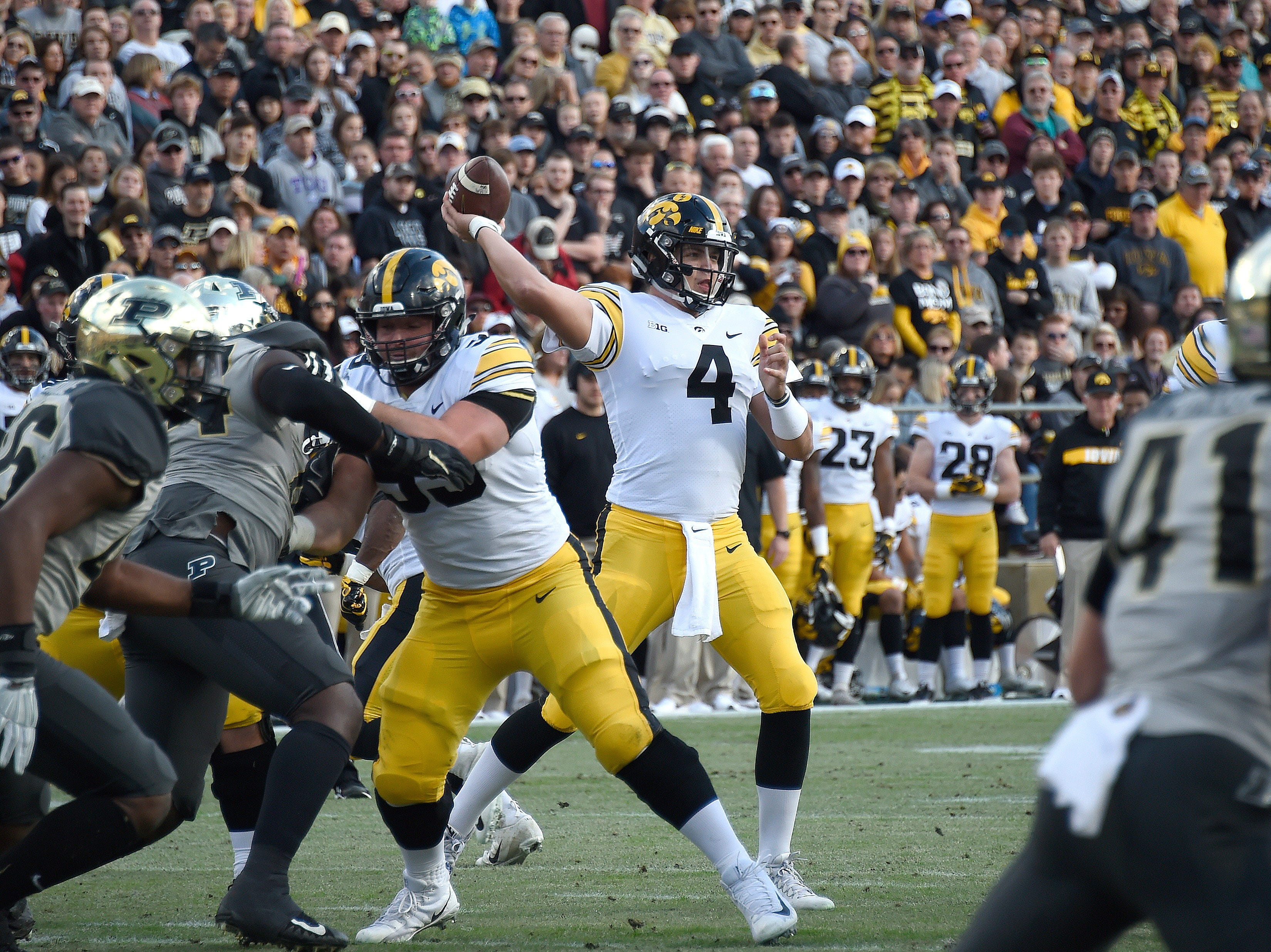Nov 3, 2018; West Lafayette, IN, USA;  Iowa Hawkeyes quarterback Nate Stanley (4) throws a pass under pressure from the Purdue Boilermakers at Ross-Ade Stadium.