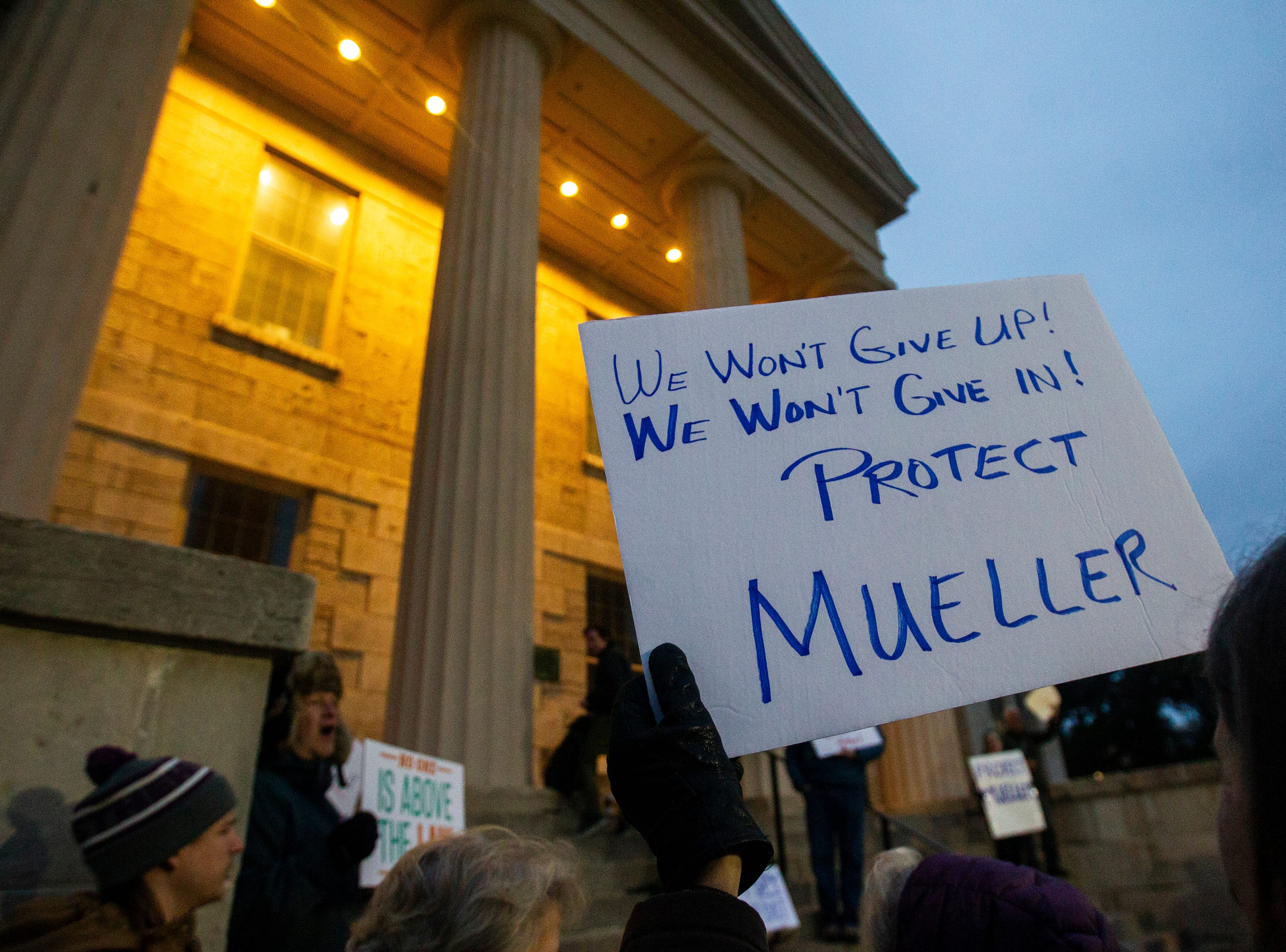 "A sign reads, ""We won't give up! We won't give in! Protect Mueller."" during a protest over the appointment of Matt Whitaker as acting U.S. Attorney General on Thursday, Nov. 8, 2018, on east side of the Pentacrest in Iowa City."