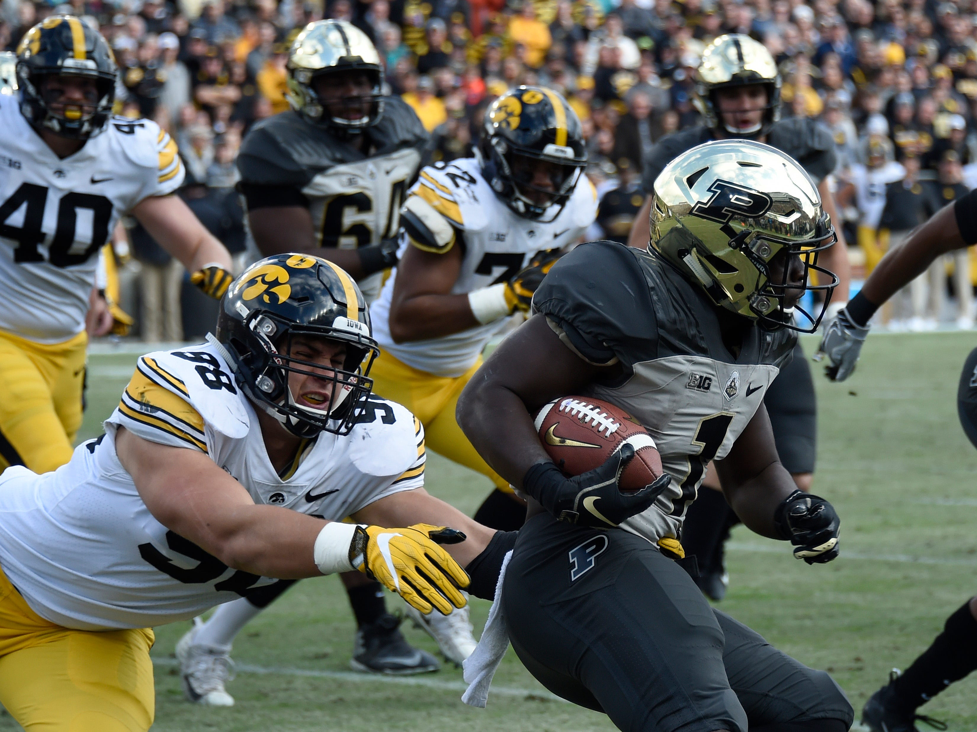 Nov 3, 2018; West Lafayette, IN, USA;  Iowa Hawkeyes defensive end Anthony Nelson (98) attempts a tackle on Purdue Boilermakers running back D.J. Knox (1) at Ross-Ade Stadium.
