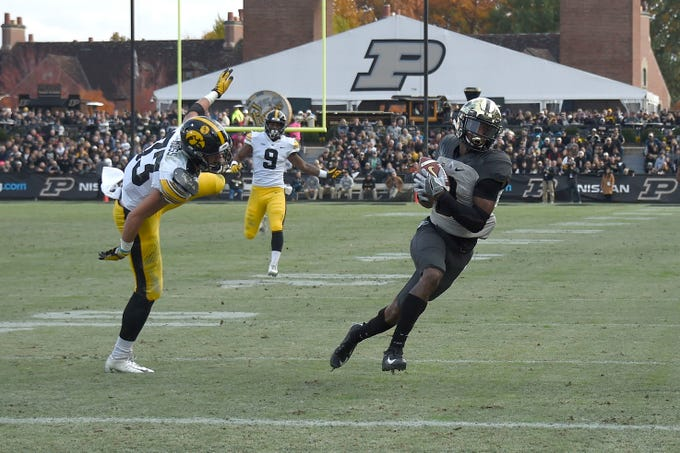 Nov 3, 2018; West Lafayette, IN, USA;  Purdue Boilermakers wide receiver Terry Wright (9) catches a pass against Iowa Hawkeyes defensive back Riley Moss (33) at Ross-Ade Stadium.