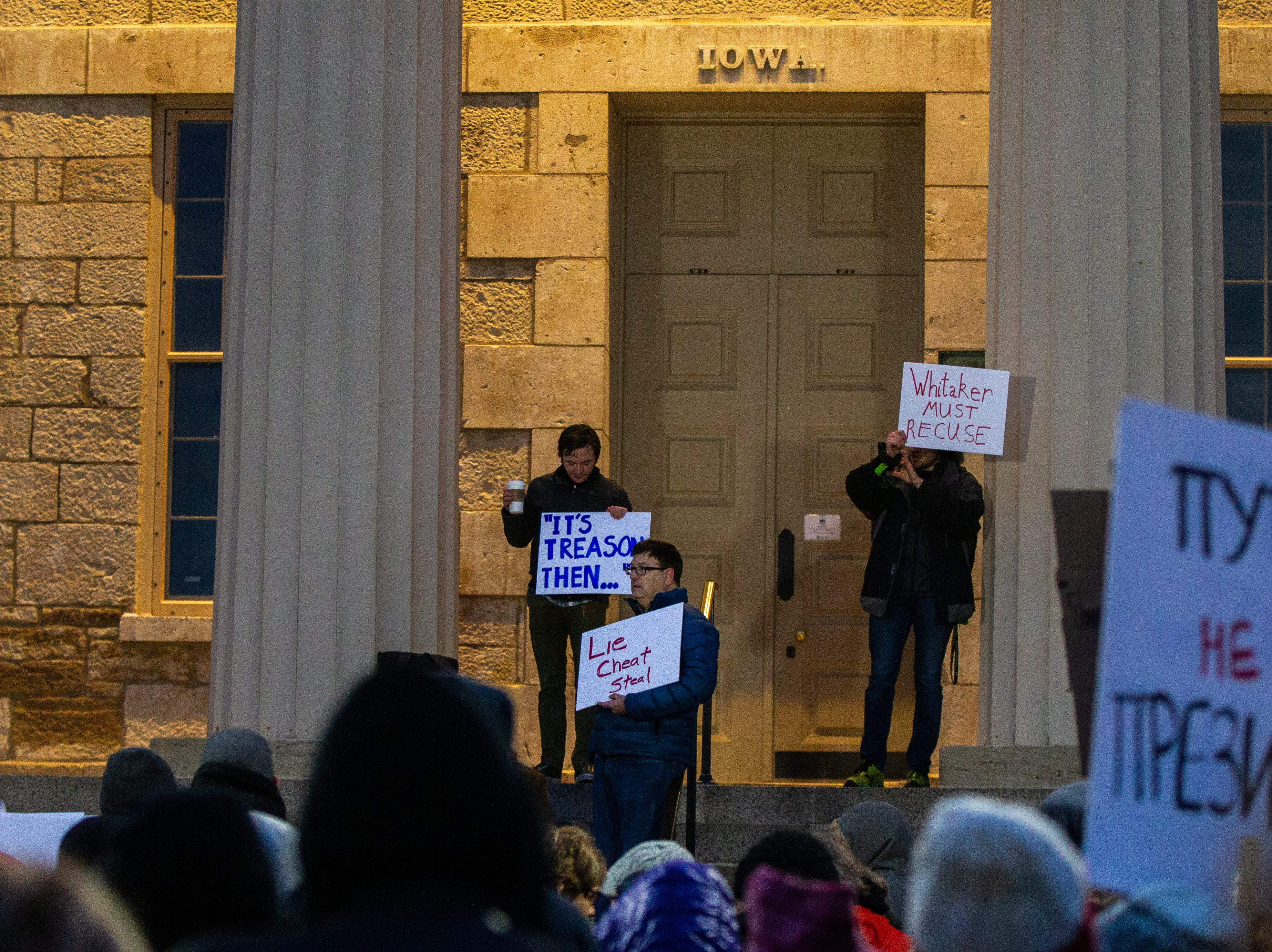 Community members gather during a protest over the appointment of Matt Whitaker as acting U.S. Attorney General on Thursday, Nov. 8, 2018, on east side of the Pentacrest in Iowa City.