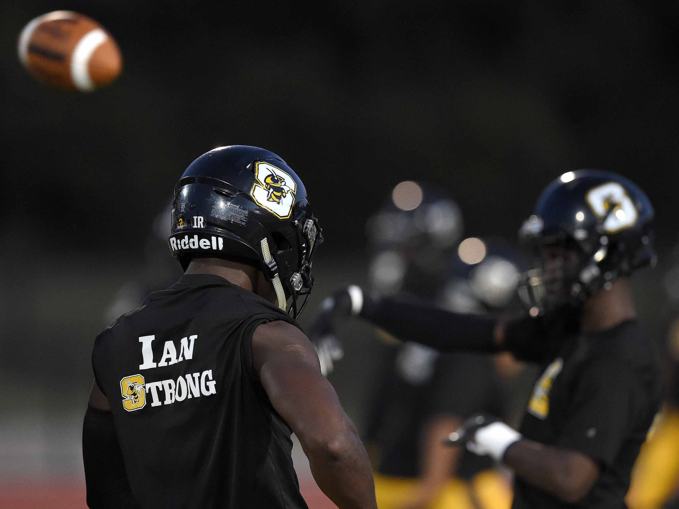 "The Starkville Yellow Jackets wore ""Ian Strong"" shirts for their warmup honoring Ian Reed, 24, a videographer who documented the school. Reed died in a Labor Day weekend car accident. Starkville played the Clinton Arrows in the final game of the regular season on Friday, November 2, 2018, at Clinton High School in Clinton, Miss."